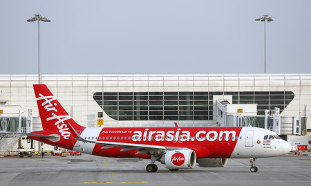 SEPANG, MALAYSIA - APRIL 17, 2019 : Air Asia Low Cost Airlines aircraft at Kuala Lumpur International Airport 2 (klia2). AirAsia operates scheduled domestic and international flights.