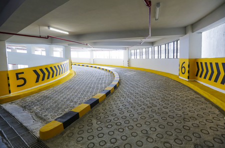 Empty spiral / curving shaped ramp entrance and exit of indoor car parking lots.