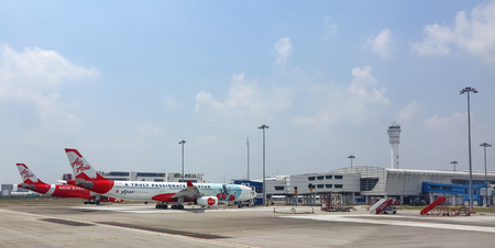 SEPANG, MALAYSIA - APRIL 18, 2019 : Air Asia Low Cost Airlines aircraft at Kuala Lumpur International Airport 2 (KLIA2). AirAsia operates scheduled domestic and international flights.