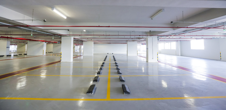 Empty indoor car parking space / lots.