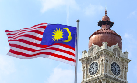 KUALA LUMPUR, MALAYSIA - AUGUST 13, 2019 : Malaysia flag also known as Jalur Gemilang waving with the background of Sultan Abdul Samad building at Dataran Merdeka. Redactioneel