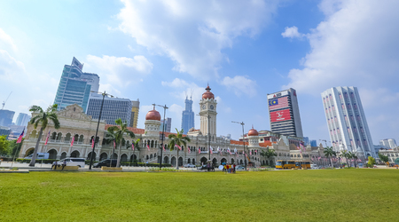 KUALA LUMPUR, MALAYSIA - AUGUST 13, 2019 : The iconic Sultan Abdul Samad building at Dataran Merdeka is one of the city's most important tourist attractions and a historical landmark.