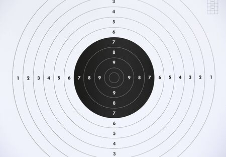 Close up of a paper target for shooting practice at shooting range. Crime or marketing concept.