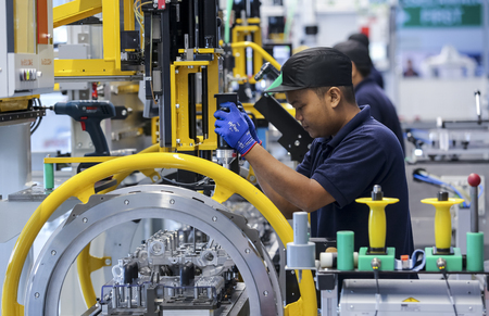 KEDAH, MALAYSIA - JULY 04, 2019 : Workers at engine assembly plant. Catering for both the domestic and export markets. Automotive & technology.