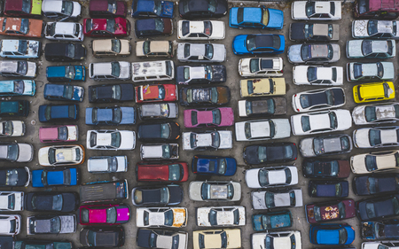 KUALA LUMPUR, MALAYSIA - SEPTEMBER 27, 2019 : Top view of unuse, unclaim, old damaged cars and other vehicle at junkyard waiting for recycling. Industrial scrap and transportation.