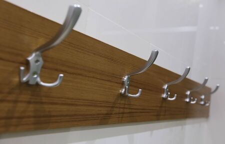 wooden hanger on wall