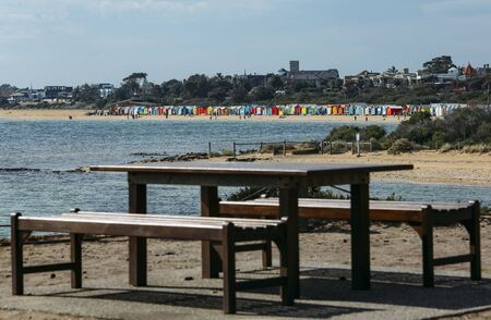 MELBOURNE, AUSTRALIA - MARCH 16, 2018 : A Melbourne iconic place for tourist, colourful bathing boxes at Brighton Beach.