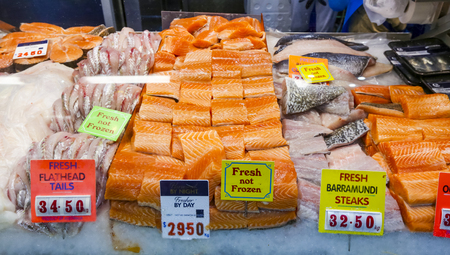 MELBOURNE, AUSTRALIA - MARCH 15, 2018 : Fresh salmon fish at tourist attraction place, Queen Victoria Market. Wet market for meat and seafood.