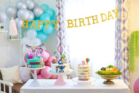 Birthday party decoration with balloon and cakes.