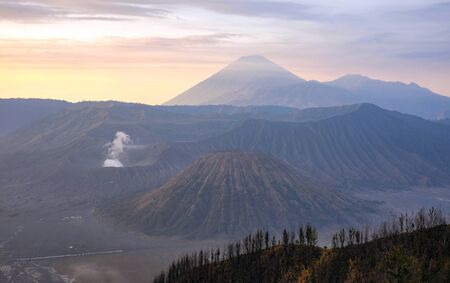 Stunning view of the Mount Bromo, Mount Batok and Mount Semeru during sunrise. Mount Bromo is an active volcano and one of the most visited tourist attractions in East Java, Indonesia.