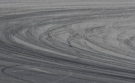 Asphalt race track detail with tire mark. Motorsports racing circuit close up. 写真素材
