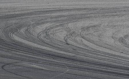 Asphalt race track detail with tire mark. Motorsports racing circuit close up. Standard-Bild