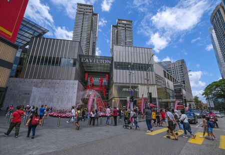 KUALA LUMPUR, MALAYSIA - FEBRUARY 22, 2020 : A crowd of people at Pavilion, Bukit Bintang or Star Hill, a tourist attraction place for shopping, eat and sightseeing. Editorial