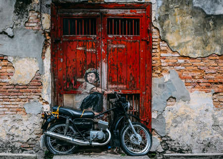 PENANG, MALAYSIA - NOVEMBER 11, 2018 : View of street art mural at George Town. Tourist attraction place to visit.