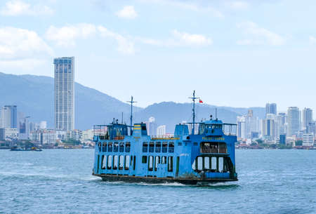 PENANG, MALAYSIA - FEBRUARY 15, 2020 : Ferry carring passengers cruising between mainland and Penang Island. Ferry is one of Penang tourism attractions.