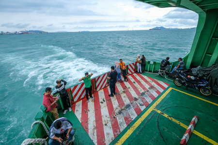 PENANG, MALAYSIA - FEBRUARY 15, 2020 : The famous Penang Ferry. Its carring passengers including car and motorcycle cruising between mainland and Island. Ferry is one of Penang tourism attractions.