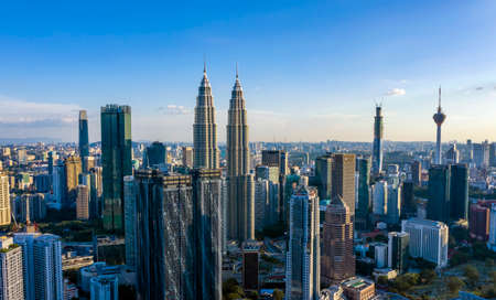 KUALA LUMPUR, MALAYSIA - MARCH 25, 2020: Aerial view of Kuala Lumpur city center skyline with Petronas KLCC Twin Towers and surrounding building in the evening.
