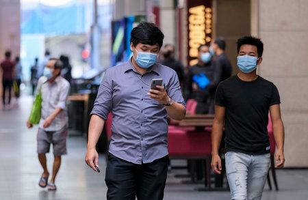 KUALA LUMPUR, MALAYSIA - MAY 04, 2020: People wearing face mask with social distancing walk at famous shopping district, Pavilion Bukit Bintang. Malaysia Coronavirus disease 2019 (COVID-19) outbreak.