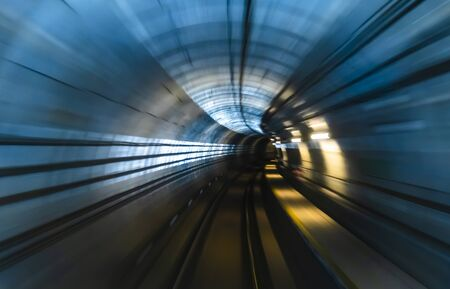 Motion blur / effect of train moving fast inside tunnel. Transportation, technology, economy and business.