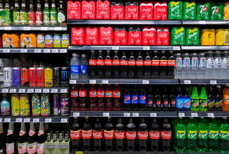 KUALA LUMPUR, MALAYSIA - MAY 04, 2020: Variety of energy drinks, soda, soft drinks, with various brands product in bottles and cans on the shelves in a grocery store supermarket. Beverages industry.
