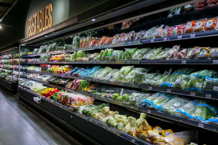 KUALA LUMPUR, MALAYSIA - MAY 04, 2020: Variety of fresh vegetables and fruits on the shelf in a grocery store supermarket. Vegetables for health diet benefits. Redakční