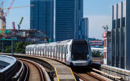 KUALA LUMPUR, MALAYSIA - MAY 05, 2020: Malaysia Mass Rapid Transit (MRT) train. People commute with MRT as transportation to work, school, travel, and shopping.