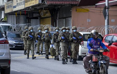 KUALA LUMPUR, MALAYSIA - MAY 15, 2020: Malaysian army at locked down area in Pudu. The area was lock down to conduct COVID-19 screening test by authorities. Coronavirus disease 2019 outbreak.