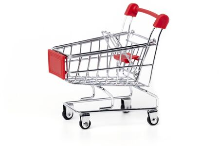 Empty trolley cart on a white background. Shopping, sale, finance and business concept. Stockfoto
