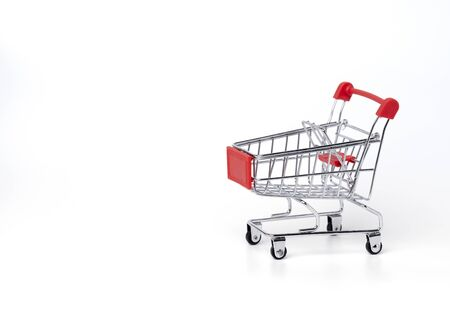 Empty trolley cart on a white background. Shopping, sale, finance and business concept.