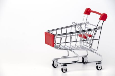 Empty trolley cart on a white background. Shopping, sale, finance and business concept. 版權商用圖片