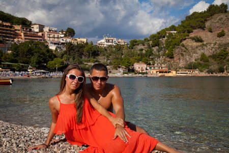 Young couple enjoying a tropical vacation in Taormina, Sicily, Italy photo