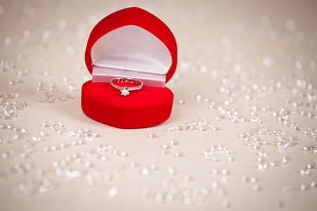 Diamond ring in heart shaped, red jewel box.