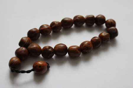 seed beads: Rosary beads made of wood on a white background