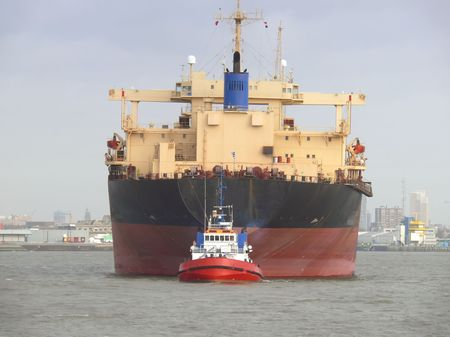 frontal view: Freighter with Tugboat - Frontal view