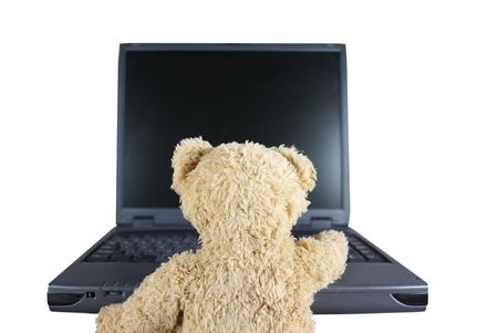 internet porn: Teddy-Bear in Front of Laptop - Symbolic for Youth, Childhood, Security, Dangers Stock Photo