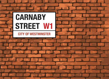 editorial: Carnaby Street London Sign On A Brick Background
