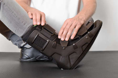 Physiotherapist applying an orthosis to a patient