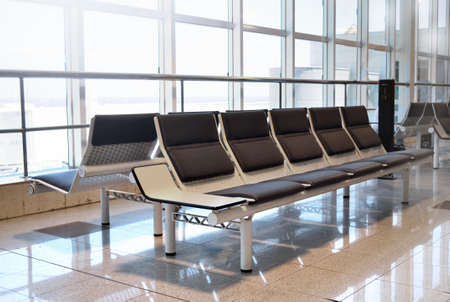 airport waiting area seats benches flight holiday Imagens