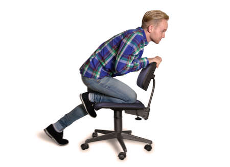 Young office Trainee driving on an office chair Stock fotó