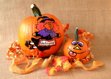 pumpkins orange with a painted witch on it