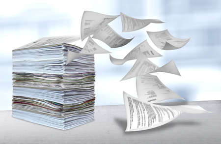 big pile of paper being blown away