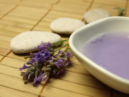 Three stones with lavender Stock Photo