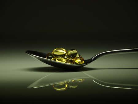 Golden Pillen auf einem Löffel Standard-Bild