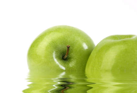 Two green apples with waves isolated on white Stock Photo - 9414952