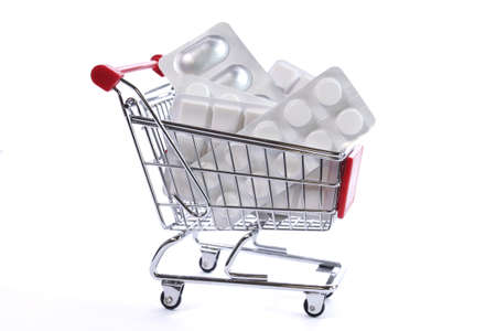 E-shop pharmacy, shopping cart with pills Reklamní fotografie