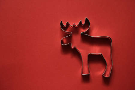 Christmas background with reindeer on red