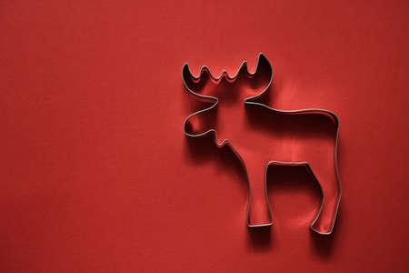 Kerst achtergrond met rendieren op rood