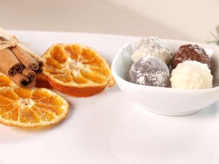 Dry orange with cinnamon and fine chocolate, Christmas background Stock Photo - 10295755