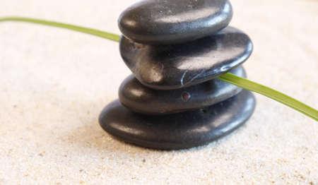 Zen garden with stacked hot stones photo