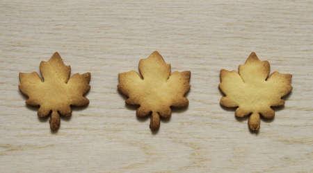 Maple leaf, cookies on a wooden background Reklamní fotografie
